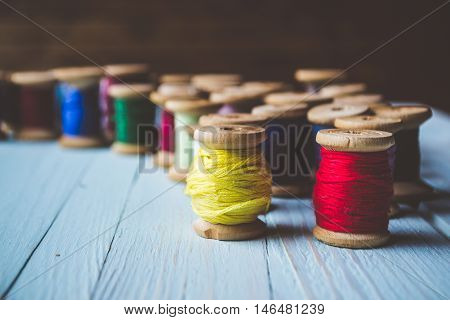 Set of old reels with colorful threads