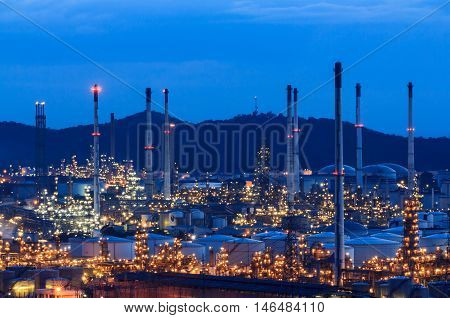 Column tower in petrochemical plant at twilight