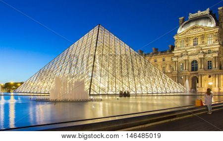 Paris France-September 08 2016 : The Louvre Pyramid based in the main courtyard ( cour Napoleon )of the Louvre Palace in Paris.It serves as the main entrance to the Louvre museum.