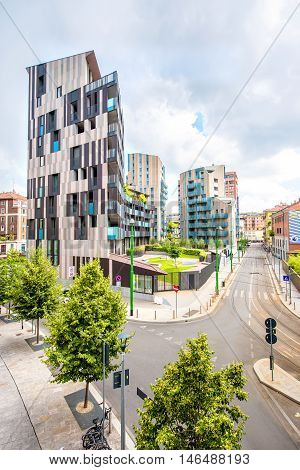 Milan, Italy - June 05, 2016: Modern residantial buildings in Porta Nuova business district in Milan. La Corte Verde complex was designed by italian architect Cino Zucchi