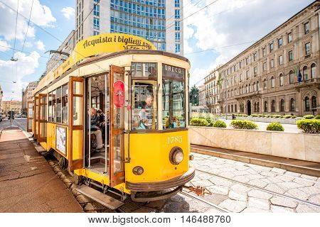 Milan, Italy - June 06, 2016: Old yellow tram with passengers on the street in Milan. The ATM Class 1500 is a series of tram vehicles used from 1927 year by the ATM in Milan
