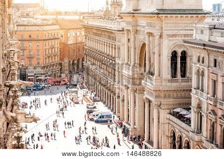 Milan, Italy - June 06, 2016: Top view on the crowded Duomo square near Vittorio Emanuele shopping gallery from the cathedral's rooftop in the center of Milan city