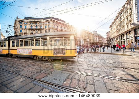 Milan, Italy - June 06, 2016: Yellow tram on Cordusio square in Milan. Cordusio in one of Milan's two main town squares and is a major transportation hub.
