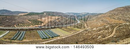 Rural landscape, farmland of settlement Shilo, the panoramic view from the archaeological park of Shiloh in Samaria, Israel poster