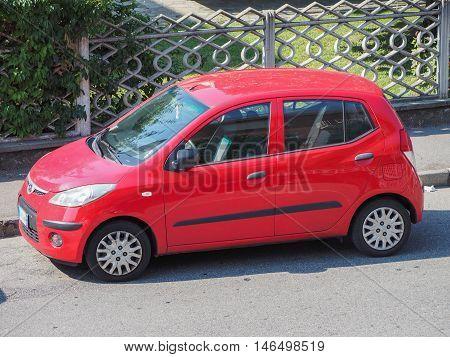 Red Toyota Yaris Car In Milan
