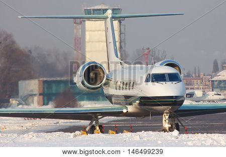 Business jet on the runway in winter getting ready for takeoff