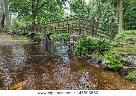 Dalegarth Walkers footbridge.  Wooden footbridge on the path from Dalegarth station to Dalegarth waterfalls, a popular tourists attraction in the English Lake District National Park.