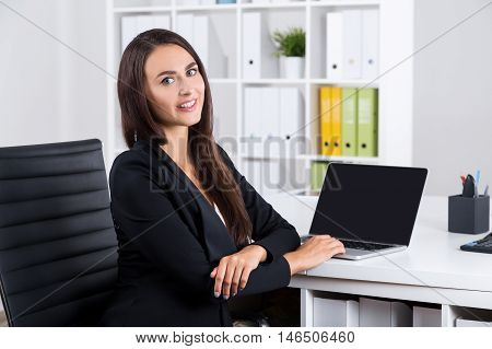 Smiling Lady With Long Hair In Office