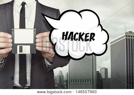 Hacker text on speech bubble with businessman holding diskette