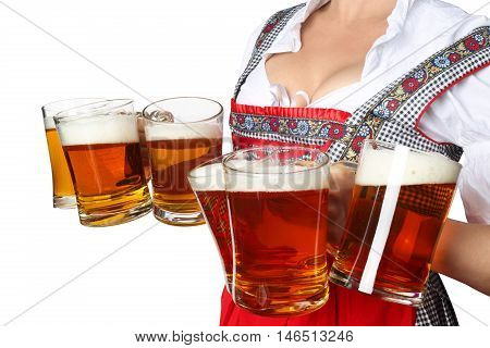 Young sexy woman wearing a dirndl with beer mugs over white Oktoberfest concept