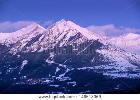 Twilight on the Petite and Grande Autane mountain peaks with  view on Saint Leger Les Melezes. Champsaur, Hautes Alpes, Southern French Alps, France