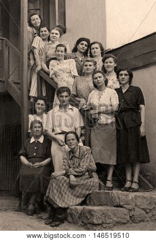 KISLOVODSK,RUSSIA - CIRCA 1946:Retro picture group of womans and men. Vintage photo from 1946 with original film grain, blur and scratches.