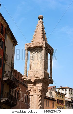 Detail of the ancient marble column with small shrine (1401) with bas relief of San Zeno (St. Zeno) in Piazza delle Erbe in Verona - Veneto Italy