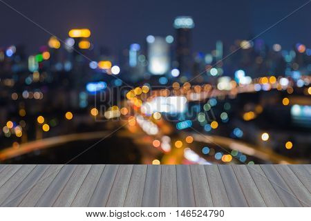 Opening wooden floor, abstract blurred lights city and highway interchanged at night
