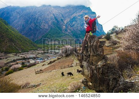 Portrait Young Pretty Girl Wearing Red Jacket Himalays Mountains.Asia Nature Morning Viewpoint.Mountain Trekking, View Village Landscape.Woman Happy Smiling.Horizontal picture. Hikking Sport Activity