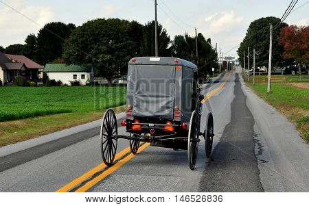Lancaster County Pennsylvania - October 13 2015: An Amish buggy driving along Route 772 near Intercourse Pennsylvania