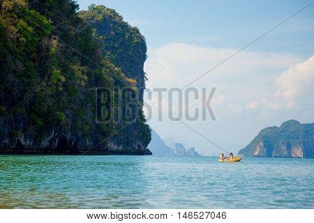 Pang Nga Thailand - March 16 2011 - Tourists kayaking in the hongs of Pang Nga Bay in the morning.