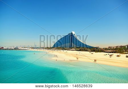 Dubai United Arab Emirates - March 23 2011 : Jumeirah Beach hotel with the pure white sand beach and crystal clear water in front of it