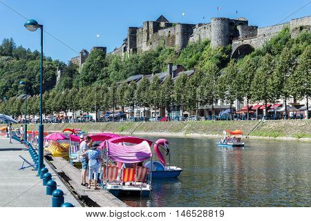 BOUILLON BELGIUM - AUG 13: Bouillon with castle and river Semois with pedalos for recreation on August 13 2016 in Bouillon Belgium