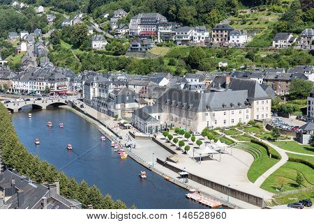 BOUILLON BELGIUM - AUG 13: Aerial view of medieval city Bouillon with pedalos in river Semois on August 13 2016 in Bouillon Belgium
