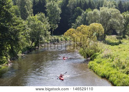 LA ROCHE-EN-ARDENNES BELGIUM - AUG 13: Man and woman in kayak on August 14 2016 at river Ourthe near La Roche-en-Ardenne Belgium