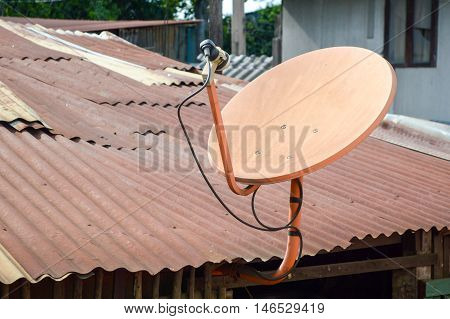 close up satellite dish on old roof