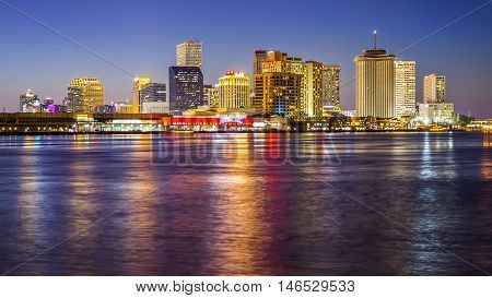 NEW ORLEANS, LOUISIANA - MAY 6th: Downtown New Orleans city skyline across the Mississippi River at sunset in New Orleans, Louisiana on May 6th, 2016.