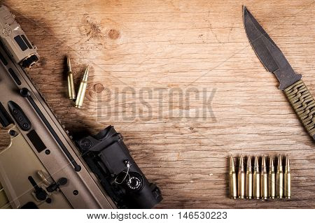 assault rifle on a old wooden table