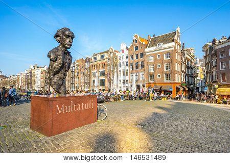 Multatuli Statue In The Square Torensluis Along The Singel Canal In Amsterdam.
