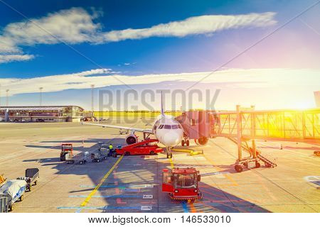 Airplane at sunrise in the terminal gate ready for takeoff - Waiting for the flight.Travel around the world