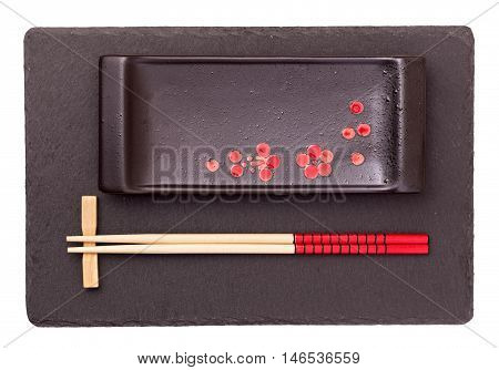 Oriental style flatware on natural slate serving tray isolated
