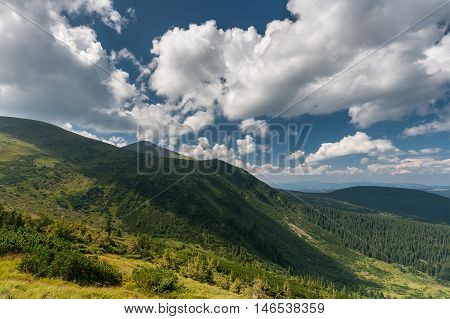Beautiful mountain landscape. Clouds hid the sun the shadow of a cloud covered the mountain. Karpaty Ukraine.