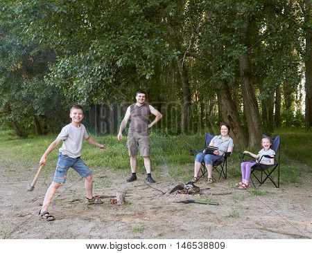 people camping in forest, family active in nature, kindle fire, summer season