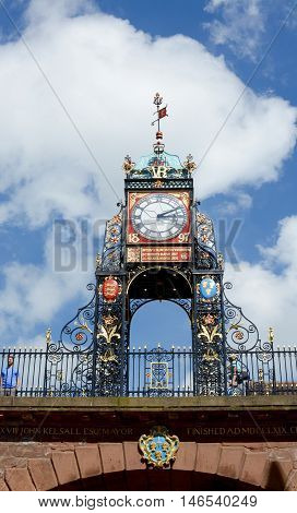 CHESTER, UK - JULY 17, 2016: Eastgate clock tower above the ancient city walls, Chester, Cheshire, UK