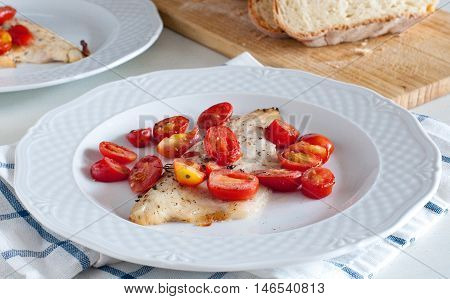 Sea bass fillet baked with cherry tomatoesitaly