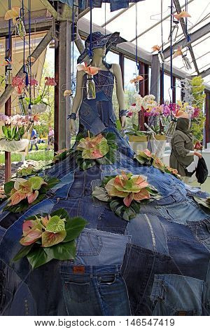 KEUKENHOF, NETHERLANDS - MAY 5, 2016: Calla lilly floristic decor and dummy in flower greenhouse in Keukenhof Garden, Lisse, Netherlands. Keukenhof is the world's largest flower garden. Selective focus