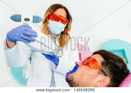 Laser teeth whitening, toned image, close up