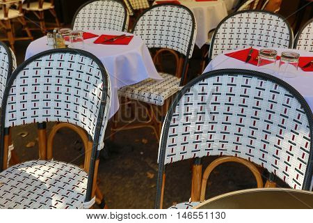 Outdoor tables ready for lunch of a typical french restaurant
