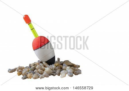 Fishing bobber on small stones with isolated background. isolated
