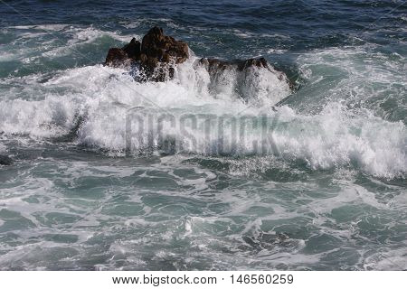 This is an image of the incoming tide taken at Asilomar Beach in Pacific Grove, California.