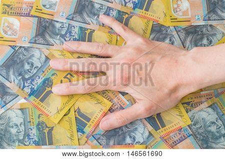 Caucasian Woman Hand on Australian Dollar Banknotes