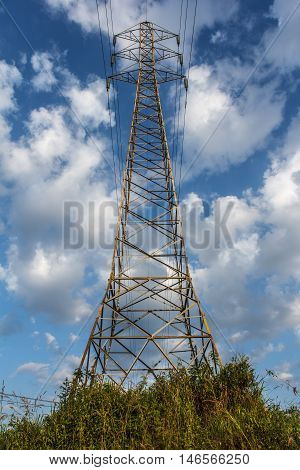 The Power transmission lines against blue sky.