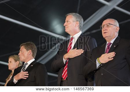 NEW YORK MAY 30 2016: Mayor Bill De Blasio and other dignitaries on stage at the annual Memorial Day Observance service on the Intrepid Sea, Air & Space Museum in Manhattan during Fleet Week NY 2016.