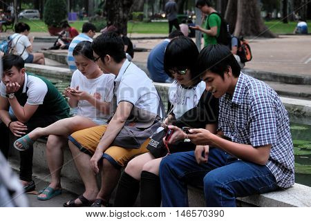 Young Asian Couple Play Pokemon Go Together