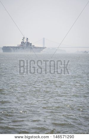 JERSEY CITY NJ - MAY 31 2016: USS Bataan (LHD 5) on the Upper New York Bay upon departing Manhattan marking the end of Fleet Week 2016, as seen from Liberty State Park.