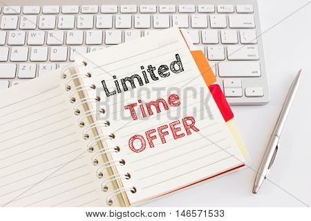 Word text Limited time offer on white paper on office table / business concept