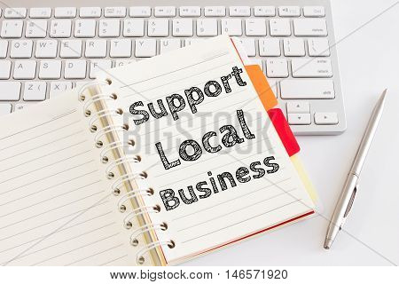 Word text Support local business on white paper on office table / business concept
