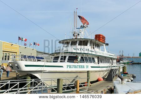GLOUCESTER, MA - AUG 8, 2015: Whale Watching Boat Privateer IV is docked at port in Gloucester city, Gloucester, Massachusetts, USA.