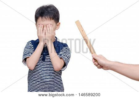Young asian boy close his face by hands between father hit him by ruler