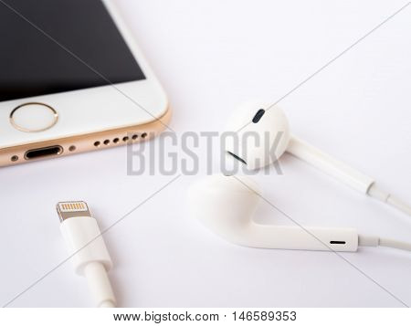 CHINGRAI THAILAND -SEPTEMBER 9 2016: Close-up image of new Apple iPhone7 mockup and new Apple EarPods mockup on white background.